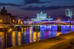 Evening view of House of Government in Moscow. View of Moscow river illuminated by evening lights royalty free stock photo