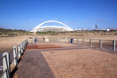 View of Moses Mabhida Stadium from Pier on Durban Beach Royalty Free Stock Photos