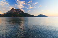 View on Moses Mountain from Adrasan beach in the morning. Turkey. View on Moses Mountain from beach in Adrasan village in the morning. Antalya Province. Turkey Royalty Free Stock Photos