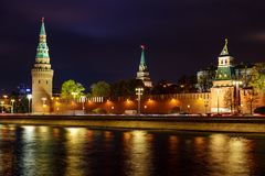 View of Moskva river on a background of Moscow Kremlin towers with night illumination stock photo