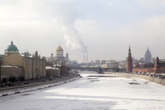 View of the Moskva River, Bridge and the Kremlin in winter time Stock Photo