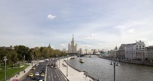 View of Moskva river and Kotelnicheskaya Embankment Building from new floating bridge in Zaryadye park, Moscow, Russia Stock Photos