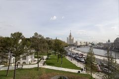 View of Moskva river and Kotelnicheskaya Embankment Building from new floating bridge in Zaryadye park, Moscow, Russia Royalty Free Stock Photo