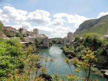 A view of Mostar Bridge in Bosnia & Herzegovina. A river view of Mostar Bridge in Bosnia and Herzegovina Royalty Free Stock Photos