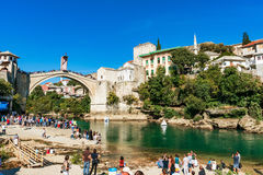 View of Mostar old town from a beach. MOSTAR, BOSNIA AND HERZEGOVINA - SEPTEMBER 23: View of Stari Most bridge and Mostar old town from a beach where people come Royalty Free Stock Photography