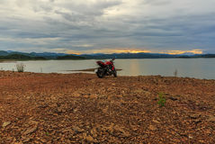 View motor bike with sunset at riverside Royalty Free Stock Images