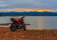 View motor bike with sunset at riverside Royalty Free Stock Photo