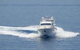 Motor yacht cruising the blue sea. View of a motor yacht cruising the blue sea. Yacht at speed, Greece stock photography