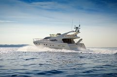 Motor-yacht cruising at full speed. View of a Motor-yacht cruising at full speed. Aegean sea, Greece stock photography