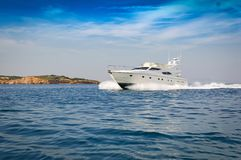 Motor-yacht cruising at full speed. View of a Motor-yacht cruising at full speed. Aegean sea, Greece stock image