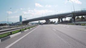 View from the motorcar of a two-tier road interchange `Adler Ring` Sochi. Scene. Krasnodar region, Russia. View from the motorcar of a two-tier road interchange stock footage
