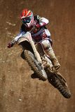 Motocross dirtbike in the air. View of a motorcross dirtbike on the dirt performing a jump Stock Photography