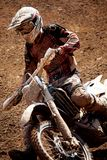 Motocross dirtbike. View of a motorcross dirtbike on the dirt performing a turn Stock Photography