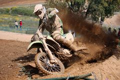 Motocross dirtbike. View of a motorcross dirtbike on the dirt performing a turn Royalty Free Stock Images