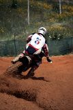 Motocross dirtbike. View of a motorcross dirtbike on the dirt performing a turn Royalty Free Stock Photo