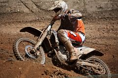 Motocross dirtbike. View of a motorcross dirtbike on the dirt performing a turn Stock Images