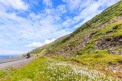 View of motorcyclists ride along scenic coastline and landscape of the Isafjordur fjord or fjord of ice, Westfjords, Iceland, Euro. Pe Stock Photo