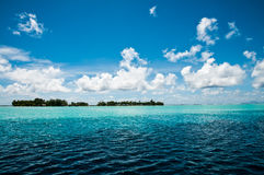 A view on a motu in the lagoon of french polynesia Royalty Free Stock Images