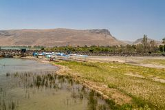 View of Mount Arbel from the coast of the Sea of Galilee, Israel. View of Mount Arbel and Mount Nitai from the coast of the Sea of Galilee near the Ginosar Royalty Free Stock Photo