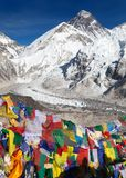 View of Mount Everest with buddhist prayer flags Stock Photos