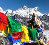 Mount Everest and Lhotse with buddhist prayer flags Stock Photos