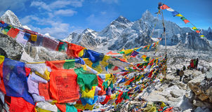 View of Mount Everest and Nuptse with buddhist prayer flags fro. M kala patthar in Sagarmatha National Park in the Nepal Himalaya royalty free stock photography