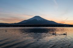 View of Mount Fuji and Lake Yamanakako. In winter evening. Lake Yamanakako is the largest of the Fuji Five Lakes stock images