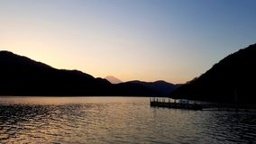 Mount Fuji at Sunset from Lake Ashi. A View of Mount Fuji at Sunset from Lake Ashi royalty free stock photo