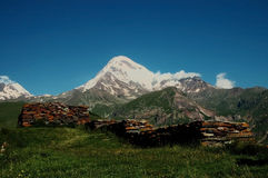 View on Mount Kazbek, Caucasus, Georgia. With a stone wall in the front Stock Photography