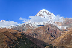 View of Mount Kazbek and Gergeti Monastery Royalty Free Stock Photography