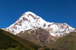 View of Mount Kazbek, near Stepantsminda. Georgia. Royalty Free Stock Photo