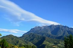 View of mount Kinabalu peak with beautiful cloud formation Royalty Free Stock Image