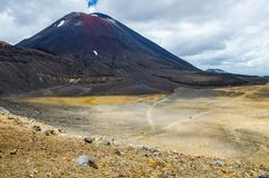 View of Mount Ngauruhoe - Mount Doom from Tongariro Alpine Crossing hike with clouds above.  stock images