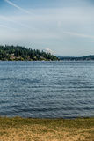 View Of Mount Rainier From Seward Park. Mount Rainier can be seen in the distance with Lake Washington  in the foregrund. Mercer Island is on the left. Shot Royalty Free Stock Image