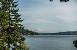 View Of Mount Rainier From Seward Park 5. Mount Rainier can be seen in the distance with Lake Washington  in the foregrund. Mercer Island is on the left. Shot Royalty Free Stock Photography