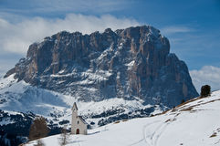 View of Mount Sassolungo. Gardena Pass, the little Church and the background Sassolungo - Dolomite, Italy royalty free stock photography