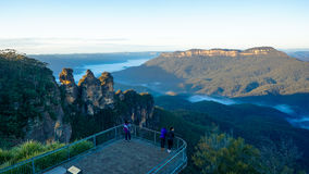 View of the Mount Solitary and The Three Sisters, Blue Mountains mountain range, Australia. View of the Mount Solitary right and The Three Sisters rock formation royalty free stock image
