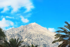 View of the Mount Tahtali on blue sky background.Kemer,Turkey. Royalty Free Stock Images