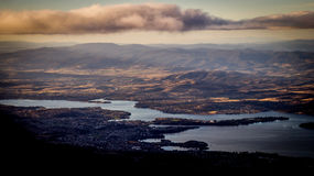 View from Mount Wellington overlooking Hobart, Tasmania, Australia. View from Mount Wellington overlooking the city of Hobart, Tasmania, Australia with clouds in Royalty Free Stock Photos