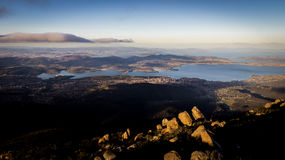 View from Mount Wellington overlooking Hobart, Tasmania, Australia. View from Mount Wellington overlooking the city of Hobart, Tasmania, Australia with rocks in Royalty Free Stock Image