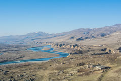 A view from the mountain at ancient heritage town Uplistsikhe. To a river Kura and hills around, Georgia, Caucasus mountains Stock Image