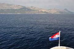 Croatian national flag flying at windy day Stock Photo