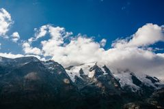 View of mountain with blue sky from Grossglockner High Alpine Road in Austria stock photography