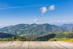 View mountain and blue sky with wood table Stock Photos