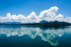 View of mountain and cloud reflections in lake. Royalty Free Stock Image