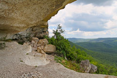 The view from a mountain grotto in the mountains. Covered with greenery Royalty Free Stock Images