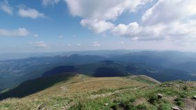 The view from the mountain Hoverla, timelapse Ukrainian Carpathian mountains. People climb to the top of the mountain. Clouds fly quickly stock footage