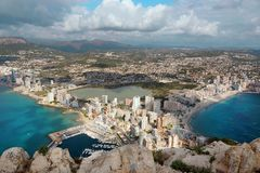 View from the mountain Ifach in Spain on the outskirts of Costa Blanca, the sea surrounds the peninsula, the city of. Kalp lies at the bottom with tall houses royalty free stock photography