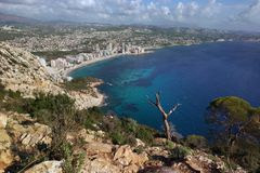 View from the mountain Ifach on a steep stony slope, the blue sea and coastal town of Kalp on the Mediterranean coast in Spain, th. E Costa Blanca region stock photos