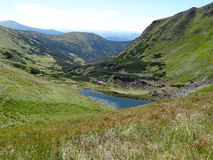 View of mountain lake in Carpathians. Royalty Free Stock Images